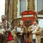 London-streets-with-students-and-phonebox-390×249
